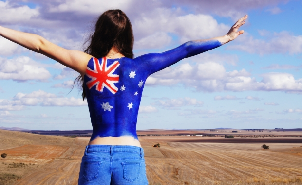 Girl with Australian flag painted on her back